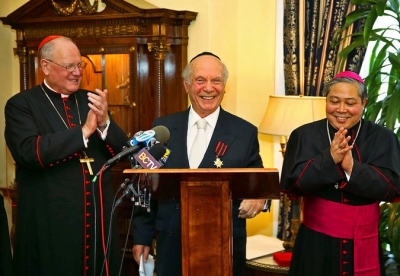 Archbishop Auza assists Cardinal Dolan in conferring knighthood on Rabbi Schneier